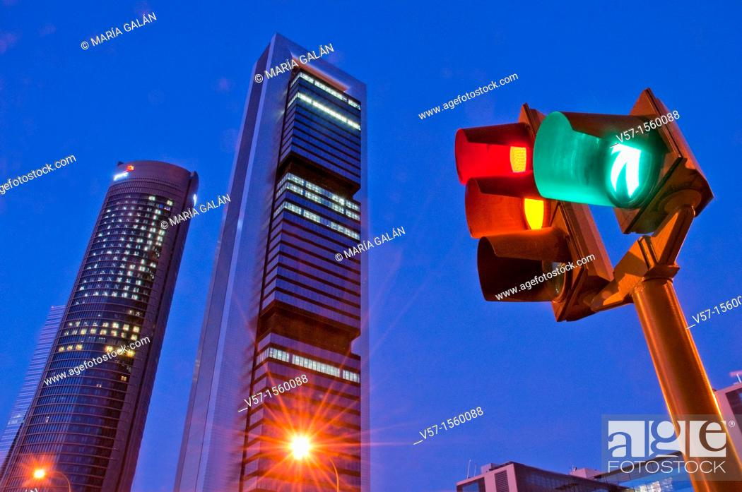 Stock Photo: Traffic light and Four Towers, night view. Madrid, Spain.