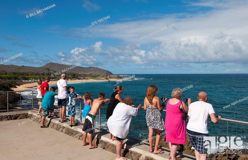 Stock Photo: Hawaii, Oahu, Honolulu, Tourists looking out over Halona Blow Hole.