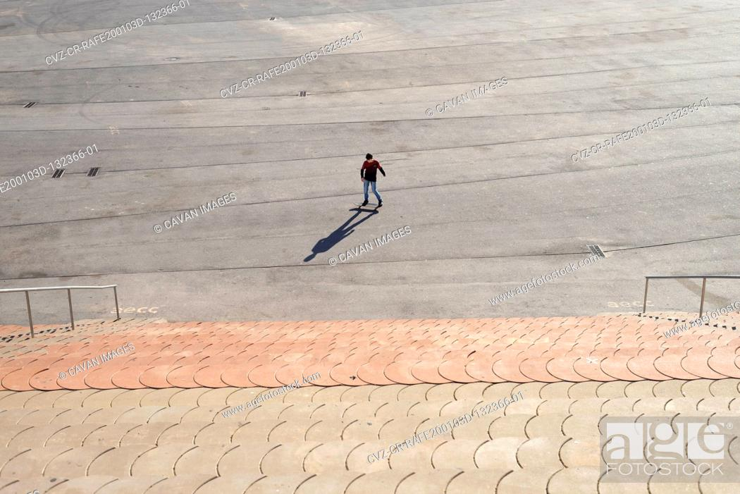 Stock Photo: Young boy skateboarding in a city park in sunny day.