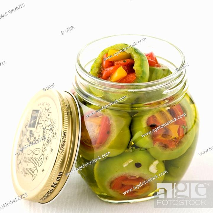 Stock Photo: green tomatoes in oil.