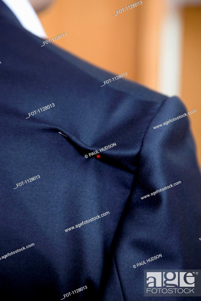 Stock Photo: Detail of a pin in the shoulder of a suit jacket.