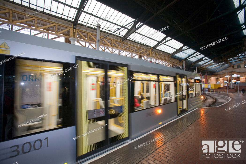 Stock Photo: New Metro Trams in Manchester city centre, UK.