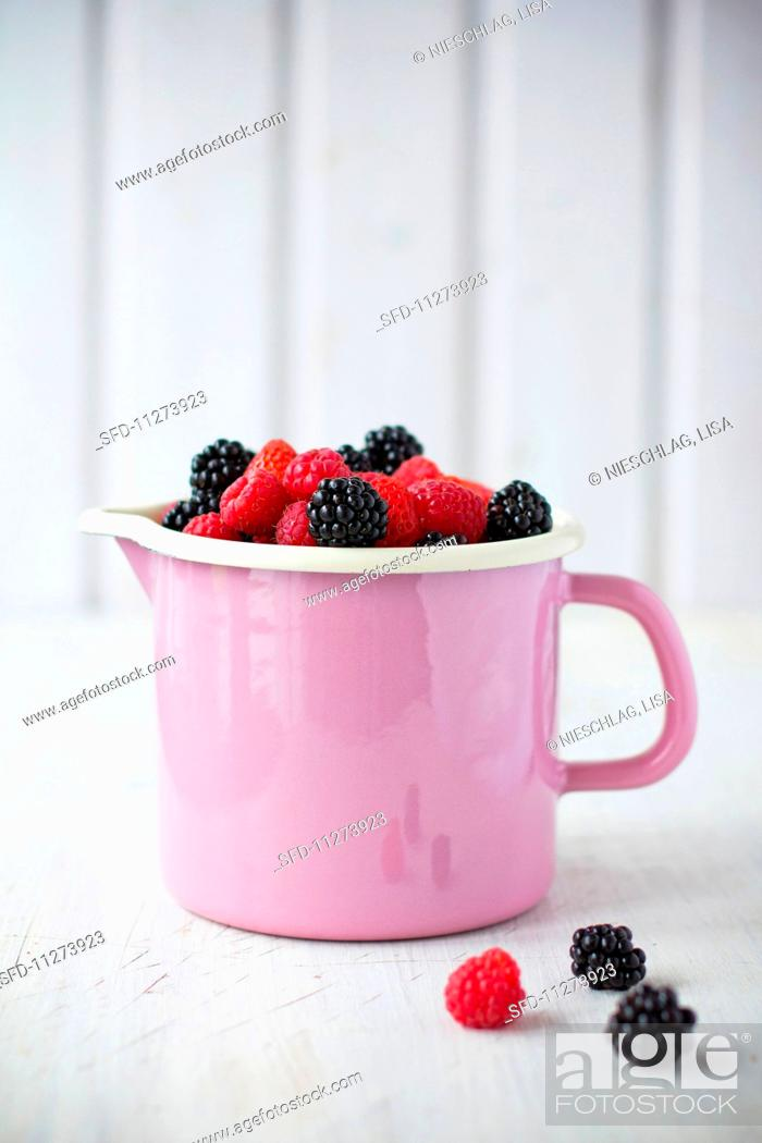 Stock Photo: A cup of mixed berries.