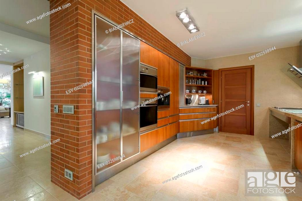 Stock Photo: Horizontal photo of grand and luxurious kitchen in a residence.