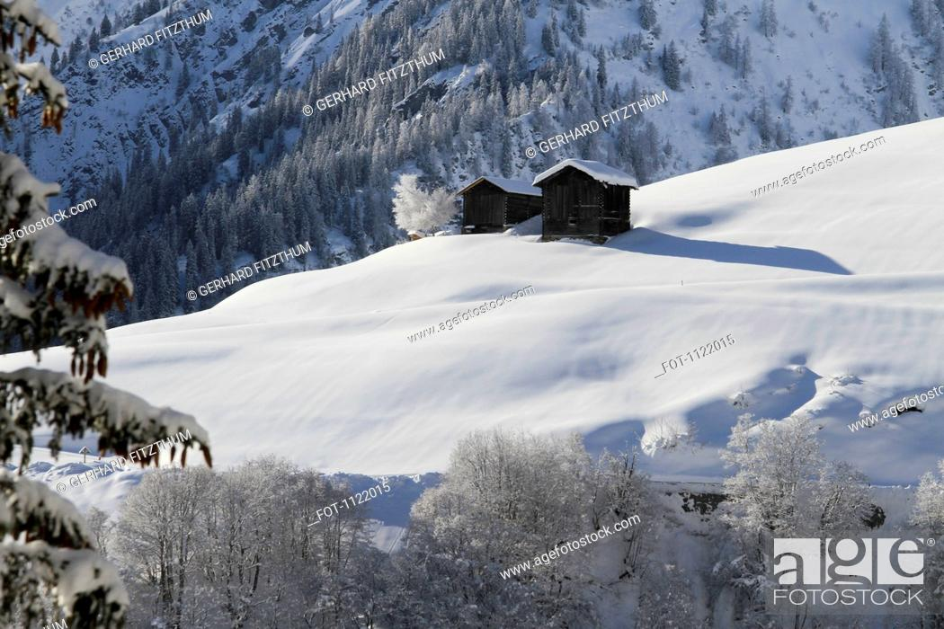 Stock Photo: Two winter chalets by mountain.