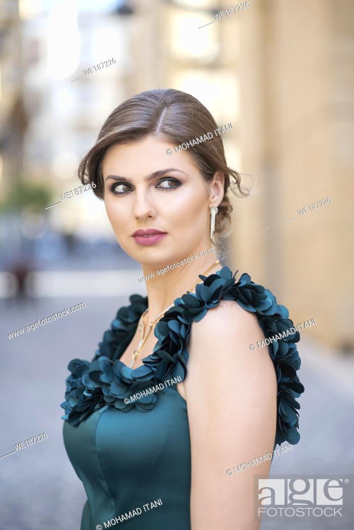 Stock Photo: Beautiful woman looking away outdoors.
