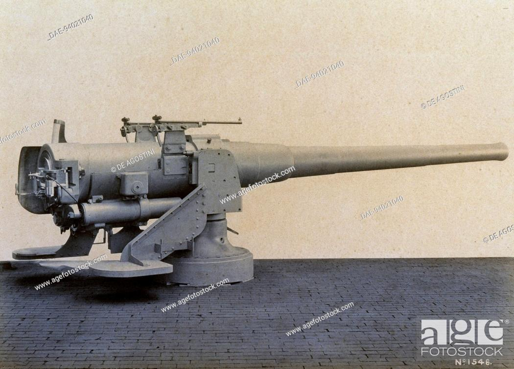 Stock Photo: 6-inch naval cannon (86/45) mounted on the turntable, without protective shields, illustration, Italy, 20th century.  Milan.