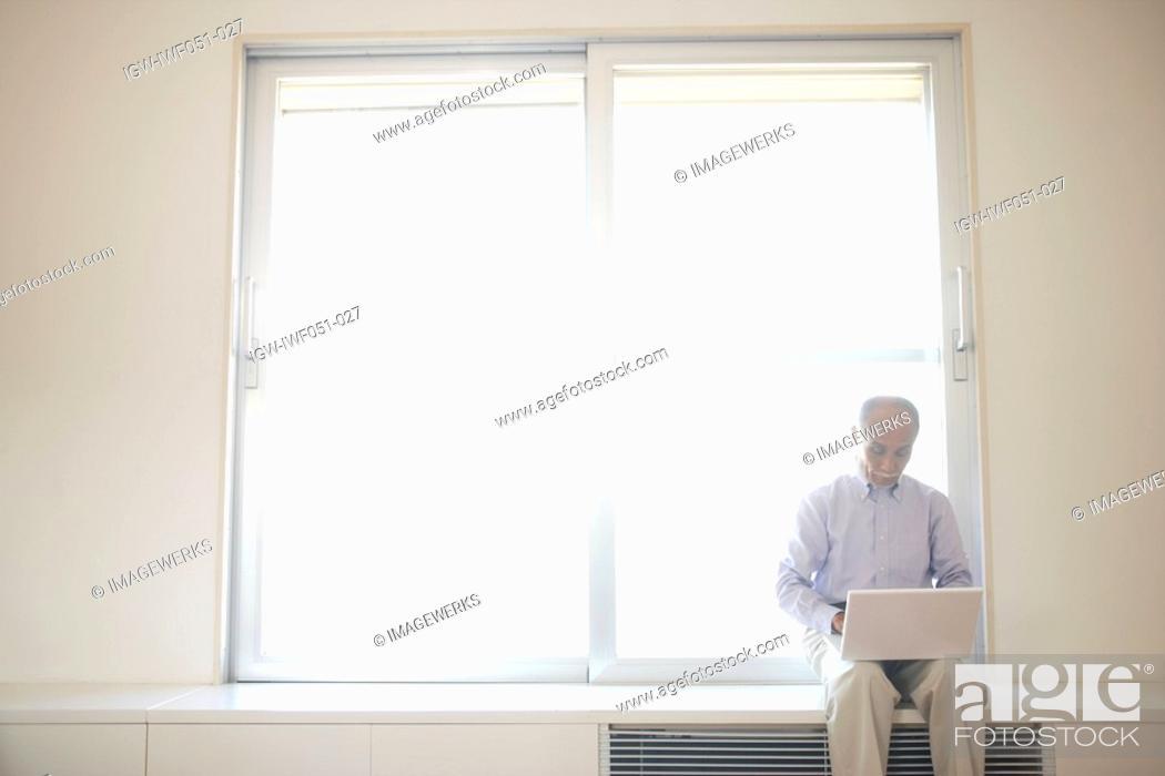 Stock Photo: Senior man using laptop.