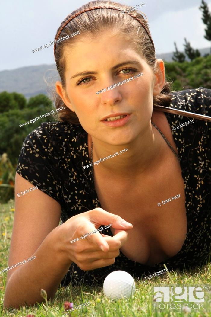 Stock Photo: woman talking to a golf ball.