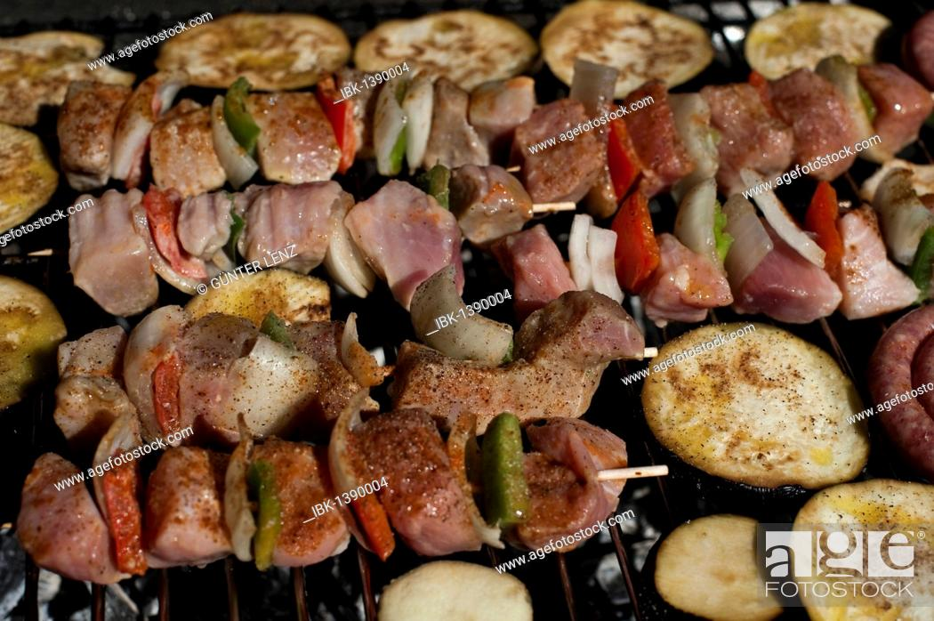 Stock Photo: Grill meat and vegetabels on skewers on a barbecue grid.