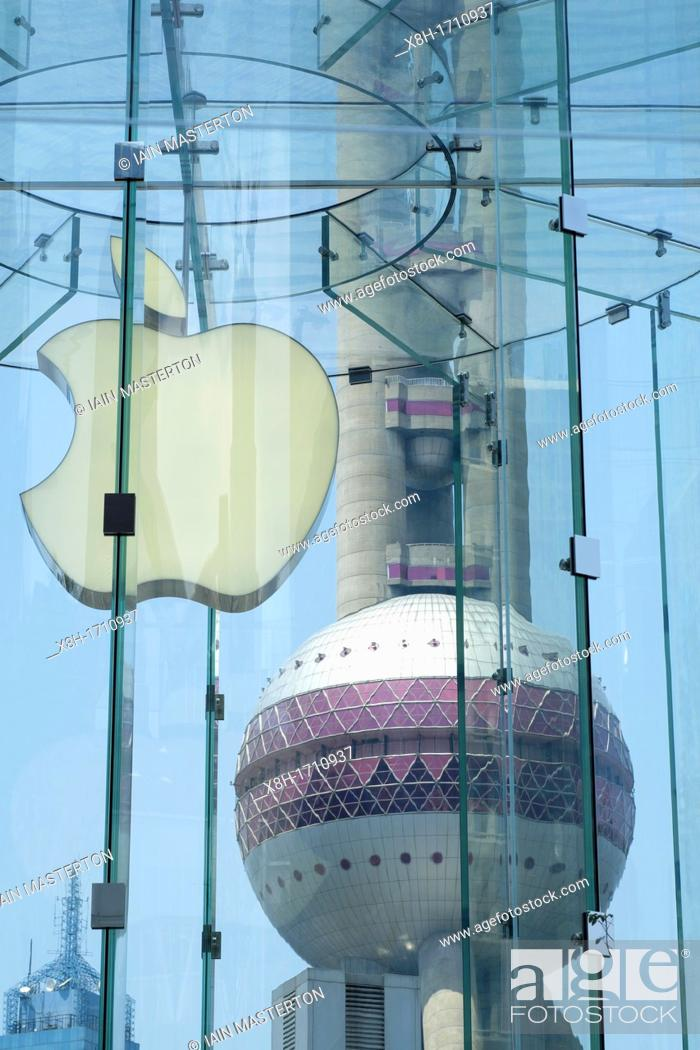 Stock Photo: Detail of Apple logo in store with Pearl Oriental Tower to rear in Shanghai China.