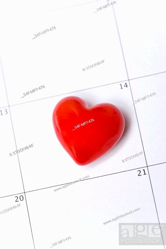 Stock Photo: Red heart on a calendar.