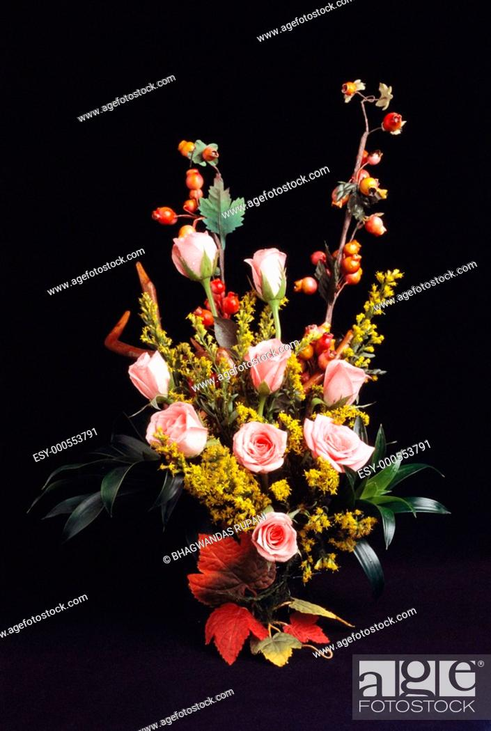 Stock Photo: Roses arrangement in bouquet on black background.