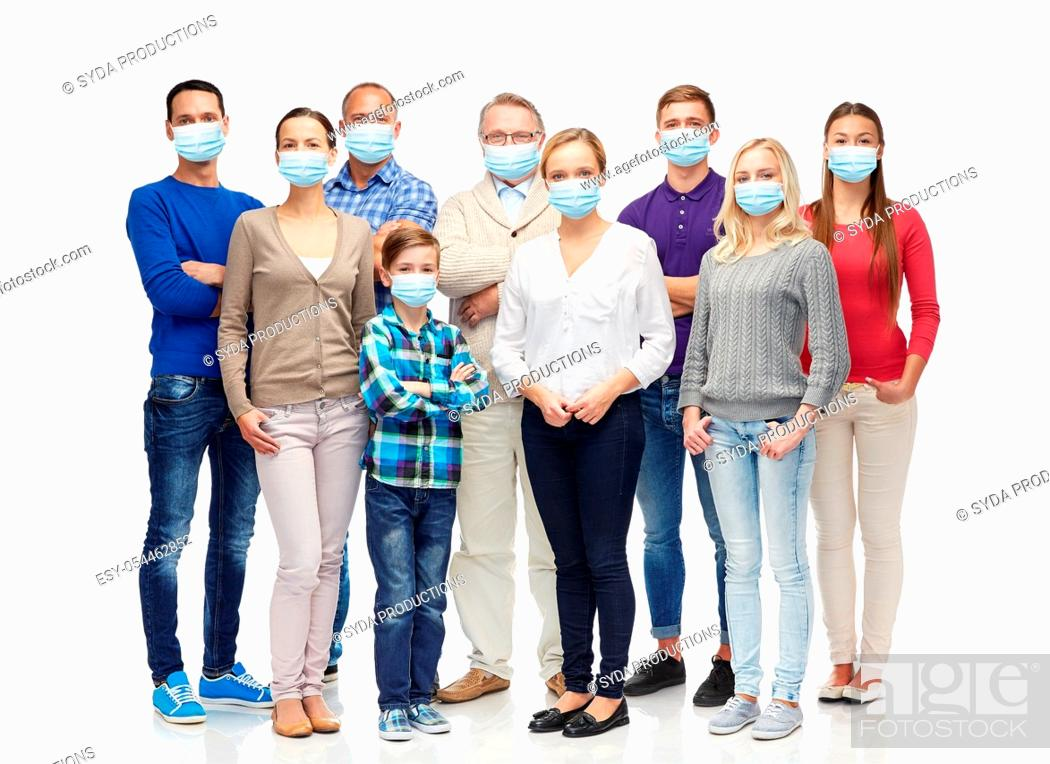 Stock Photo: group of people of different age in medical masks.