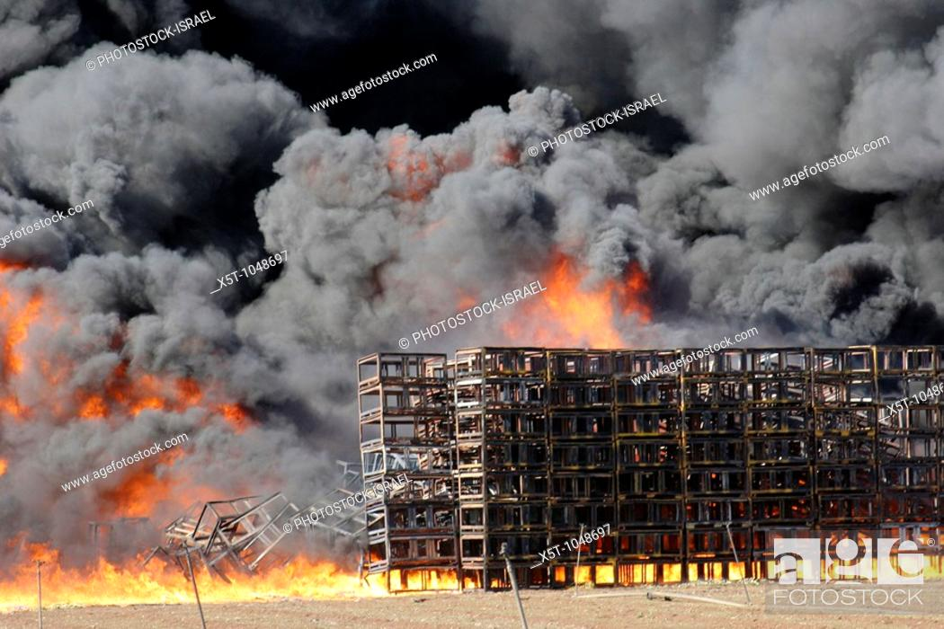 Stock Photo: Israel, Galilee, a raging wild fire in an agricultural packing plant.