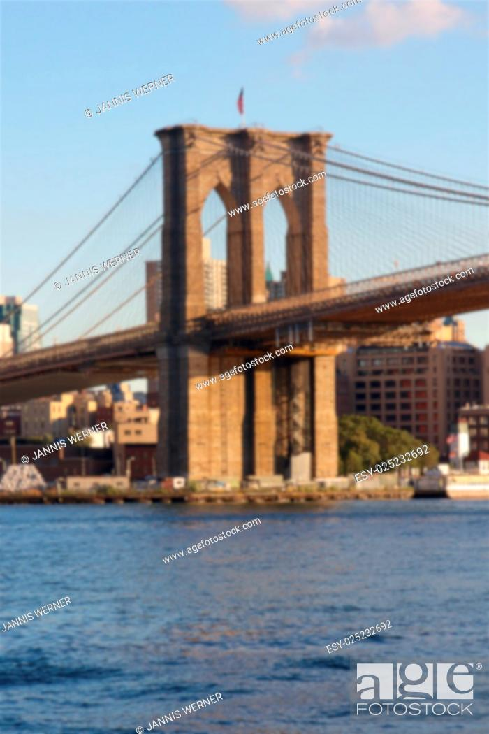 Stock Photo: Blurred background of East tower of the Brooklyn Bridge as seen from Lower Manhattan, New York, NY, USA.