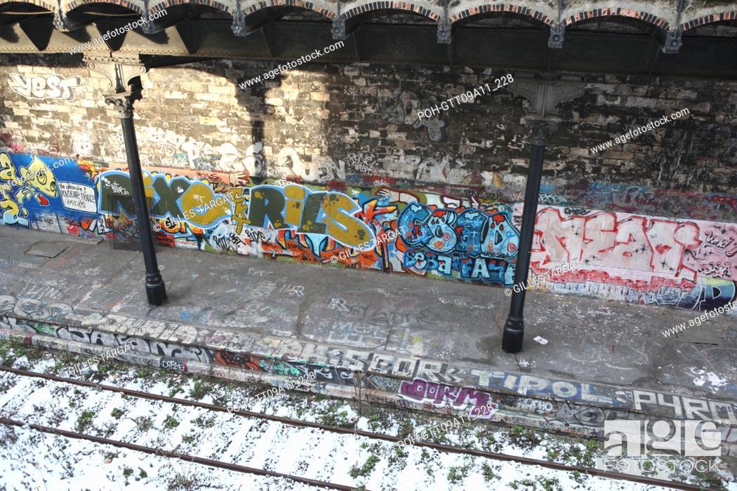 Stock Photo: tourism, France, paris 18th arrondissement, former railways, railroad, petite ceinture, railway, wall, graffiti, graffiti, graf, snow, quai, train, rue belliard.