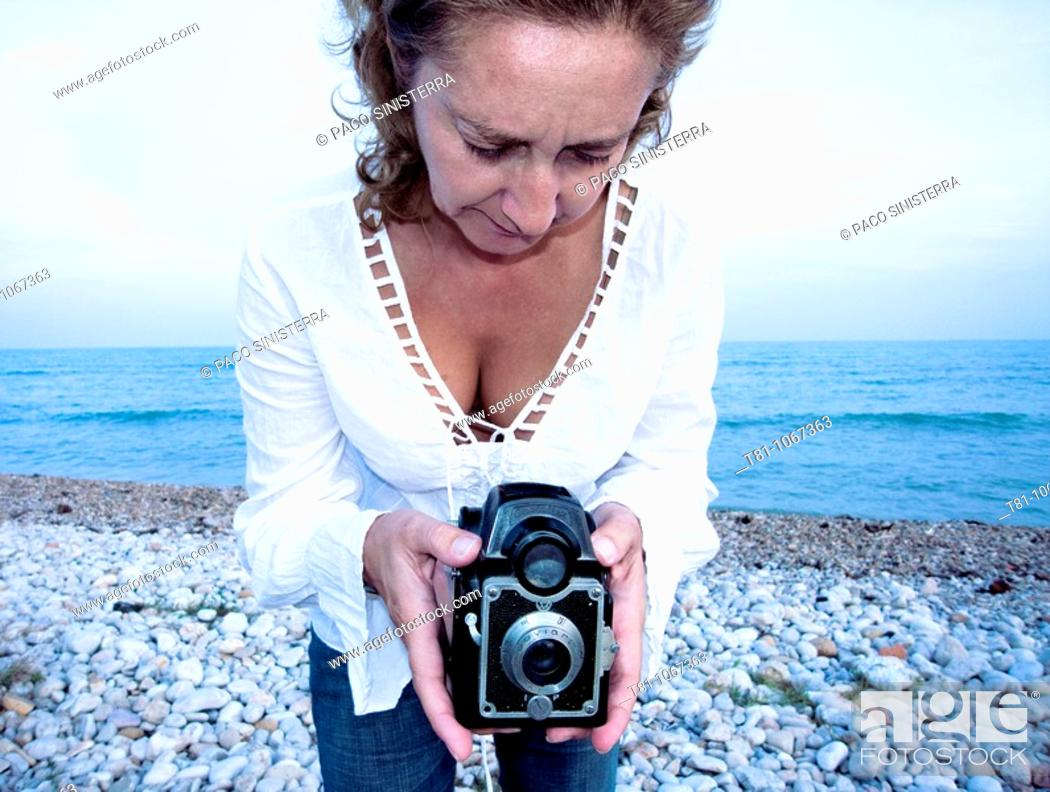 Stock Photo: woman taking pictures.
