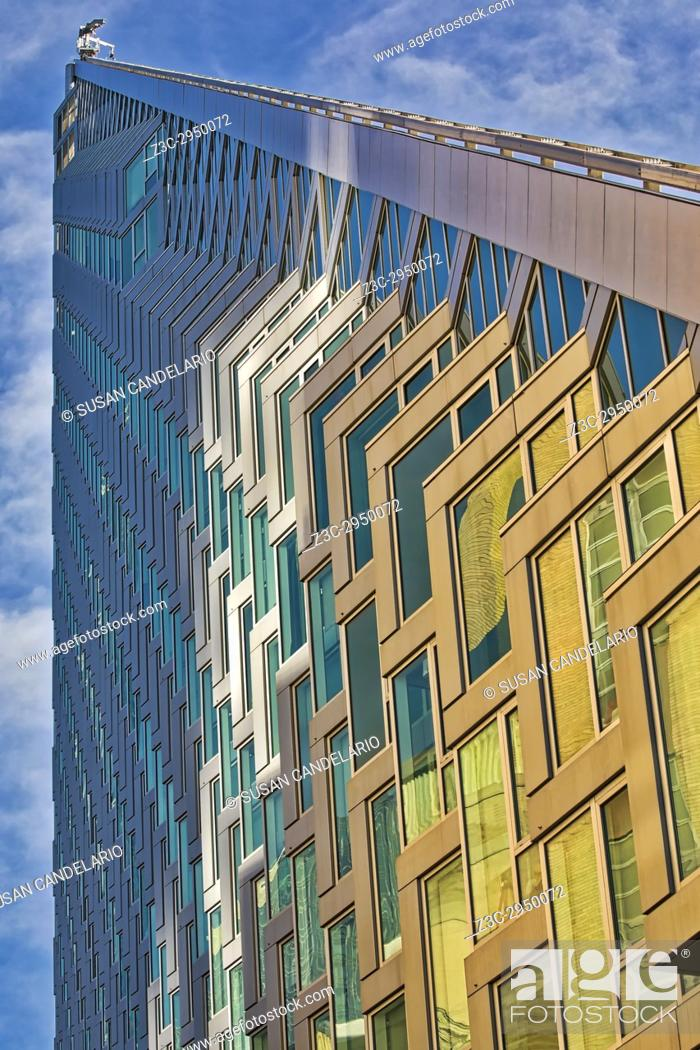 Stock Photo: Upward View to West 57 ST NYC - An upward view to the pyramid shape modern building at 625 West 57th Street in midtown Manhattan, New York City.