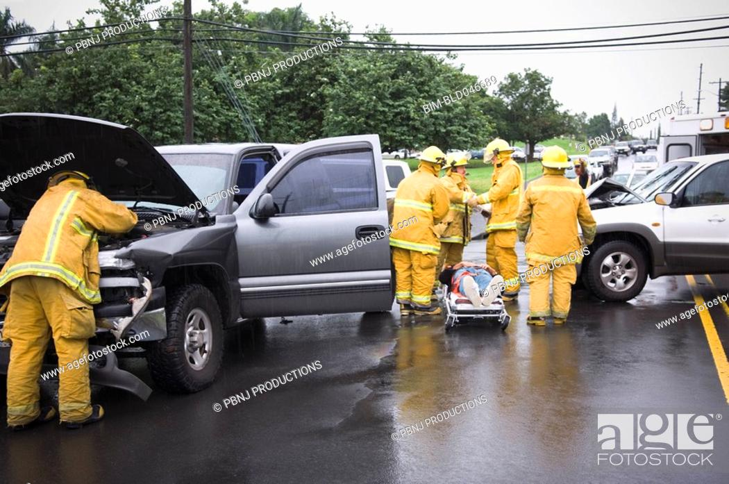 Stock Photo: Firefighters at accident scene.