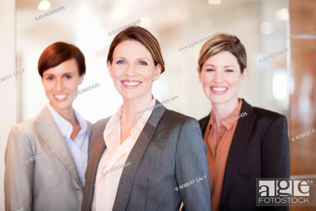 Stock Photo: Portrait of smiling businesswomen.