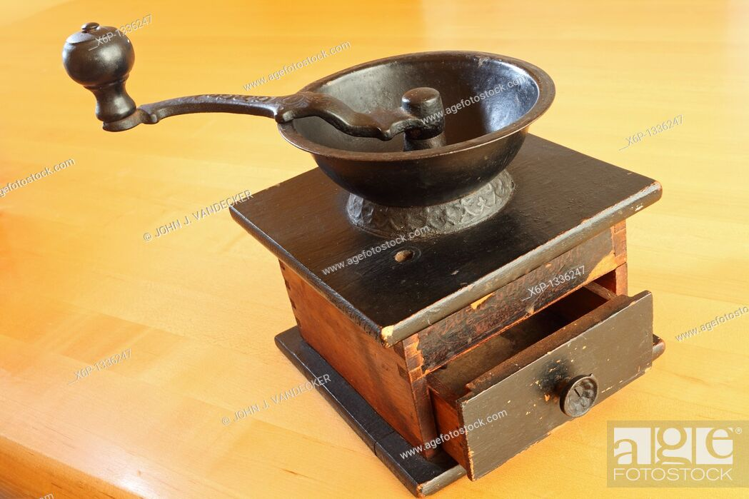 Stock Photo: Still-life of an antique hand cranked tabletop coffee grinder  Manufactured by the C P  Co  the grinder dates back to the late 19th or early 20th century.