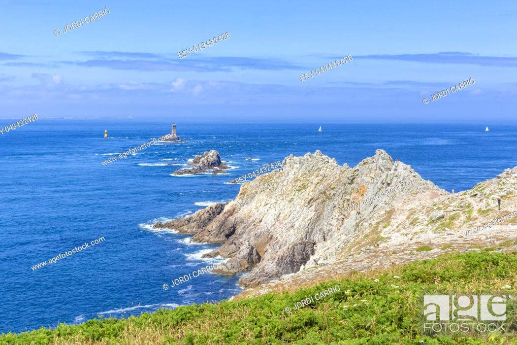 Stock Photo: View from the tip of Cape Raz, the strait of Sein Island with the old lighthouse in the background, in the French Brittany.