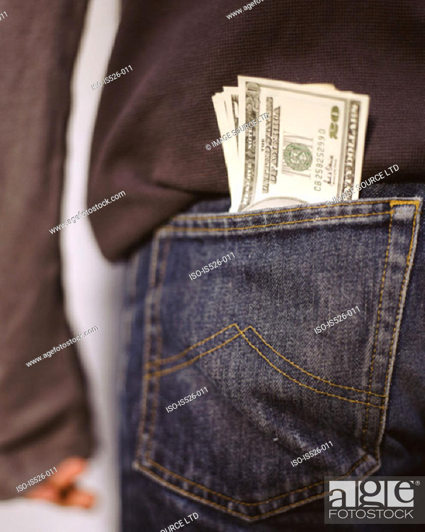 Stock Photo: US dollars sticking out a back pocket.