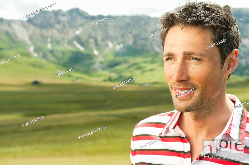 Stock Photo: Italy, Seiseralm, Man in field, portrait, close-up.