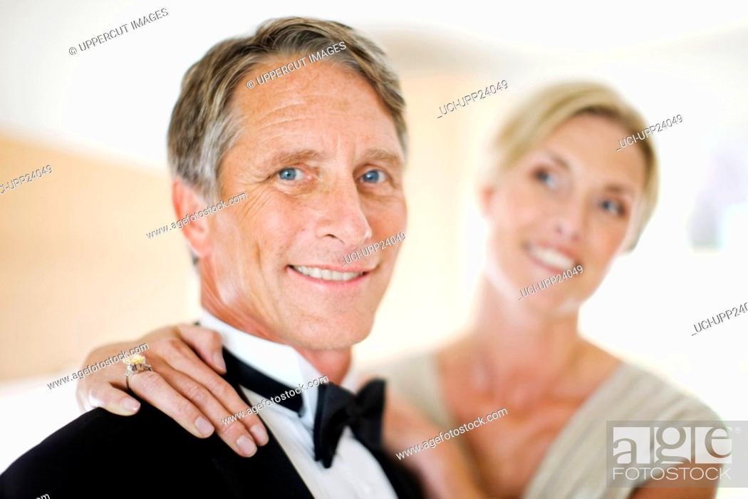 Stock Photo: Portrait of couple in evening wear.