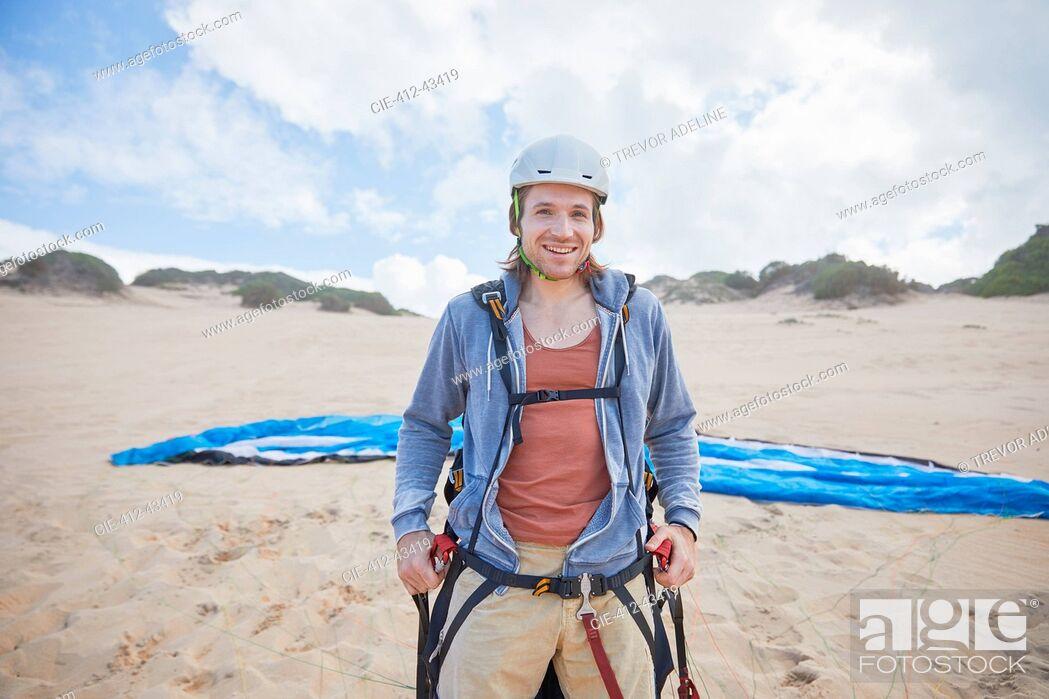 Stock Photo: Portrait confident male paraglider on beach.