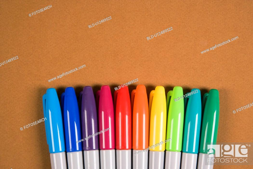 Stock Photo: Group of colorful markers lined up in a row.