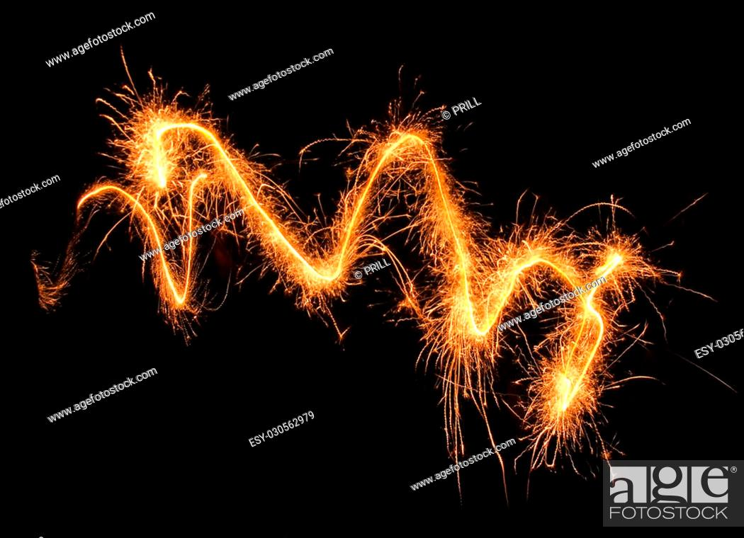 Stock Photo: swinging, sparkling and glowing fireworks in dark back.