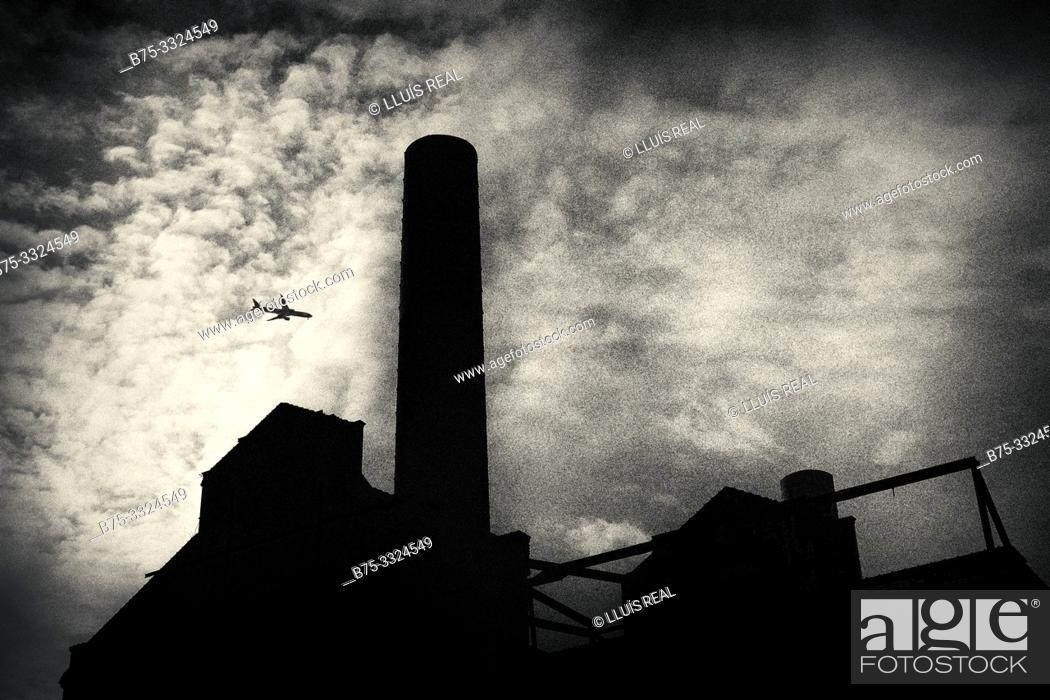 Stock Photo: Silhouette with clouds and a plane. Lots Road Power Station. Londes, UK, Europe.