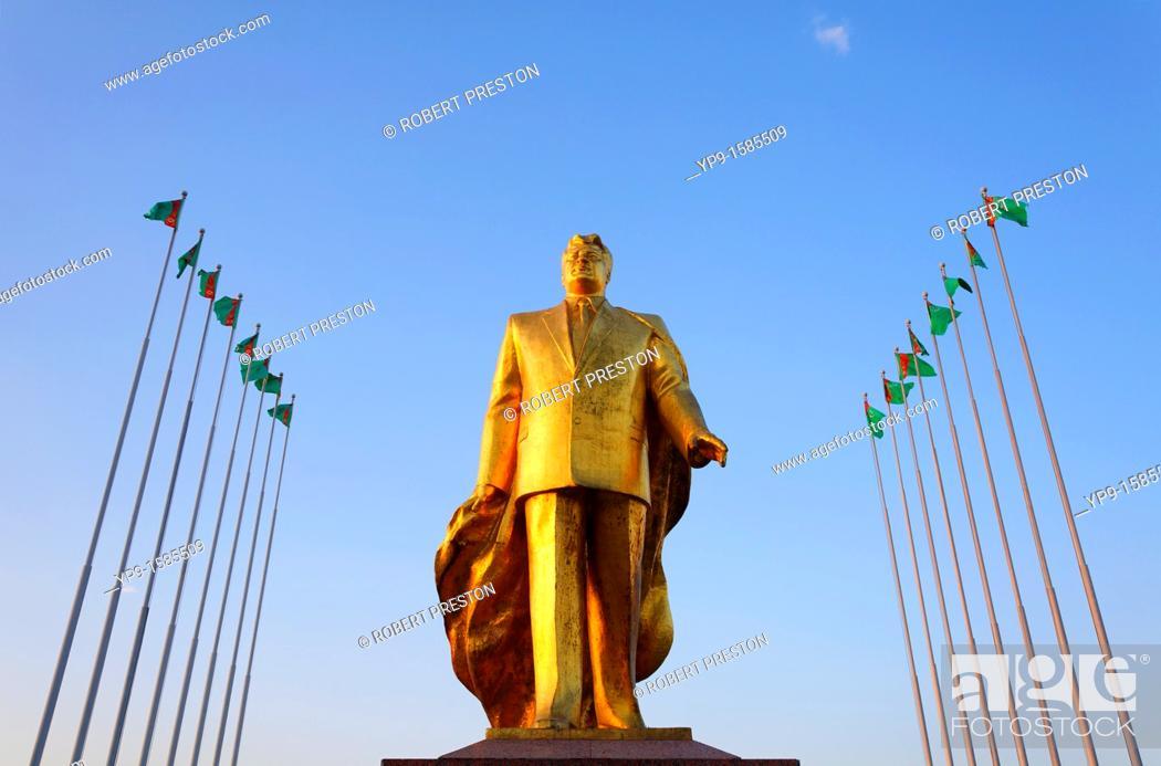 Stock Photo: Golden statue of Niyazov in the Park of Independence, Berzengi, Ashgabat, Turkmenistan.