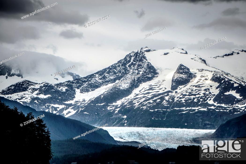 Stock Photo: mountain range scenes in june around juneau alaska.