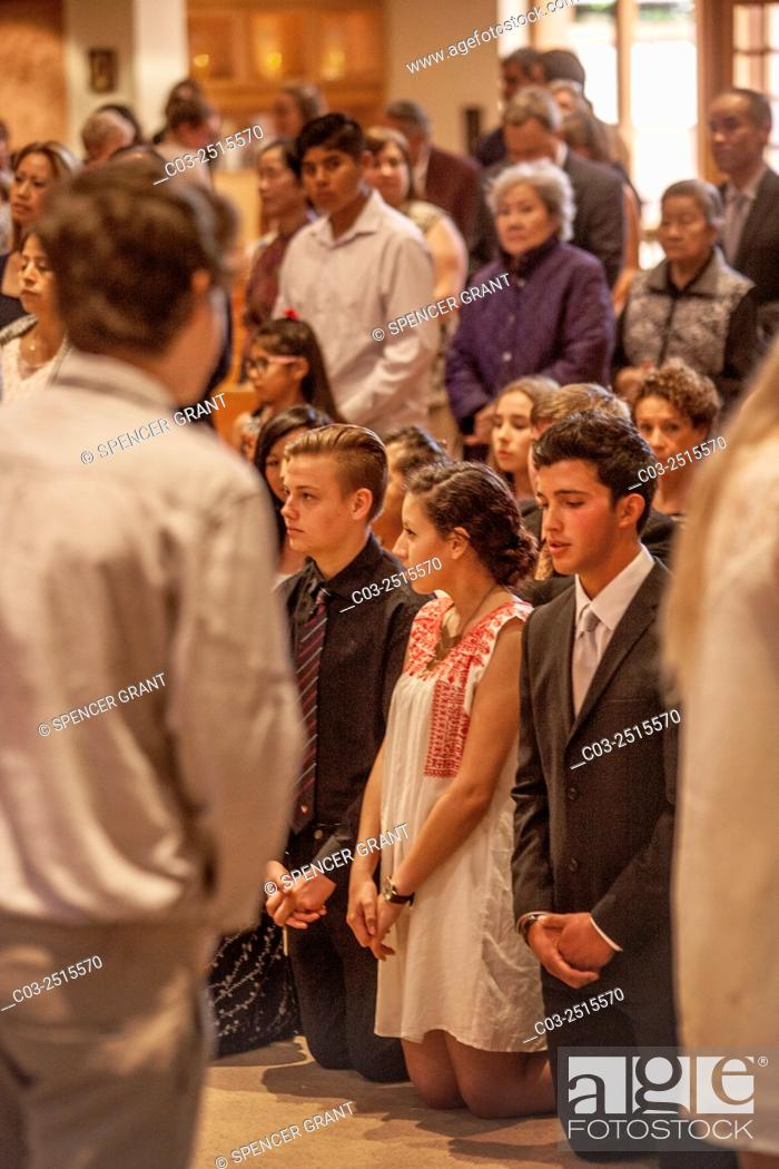 Formally Dressed Teen Boys And Girls Pray On Their Knees During