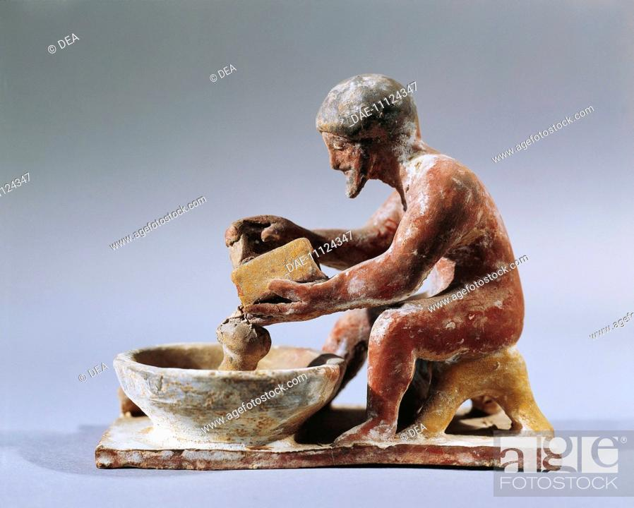 Stock Photo: Greece - Archaic period, 6th century b.C. Painted terracotta figurine. Man grating cheese. From Ritsona  Tebe, Museo Archeologico.
