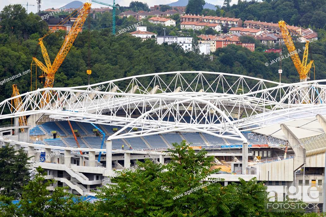 Stock Photo: Giant cranes supporting metal structure, Truss Placement, Anoeta Stadium Cover, Amara, Donostia, San Sebastian, Gipuzkoa, Basque Country, Spain.