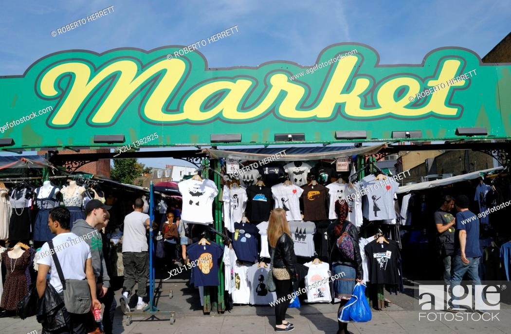 Stock Photo: A sign reading 'Market' above a clothes market.