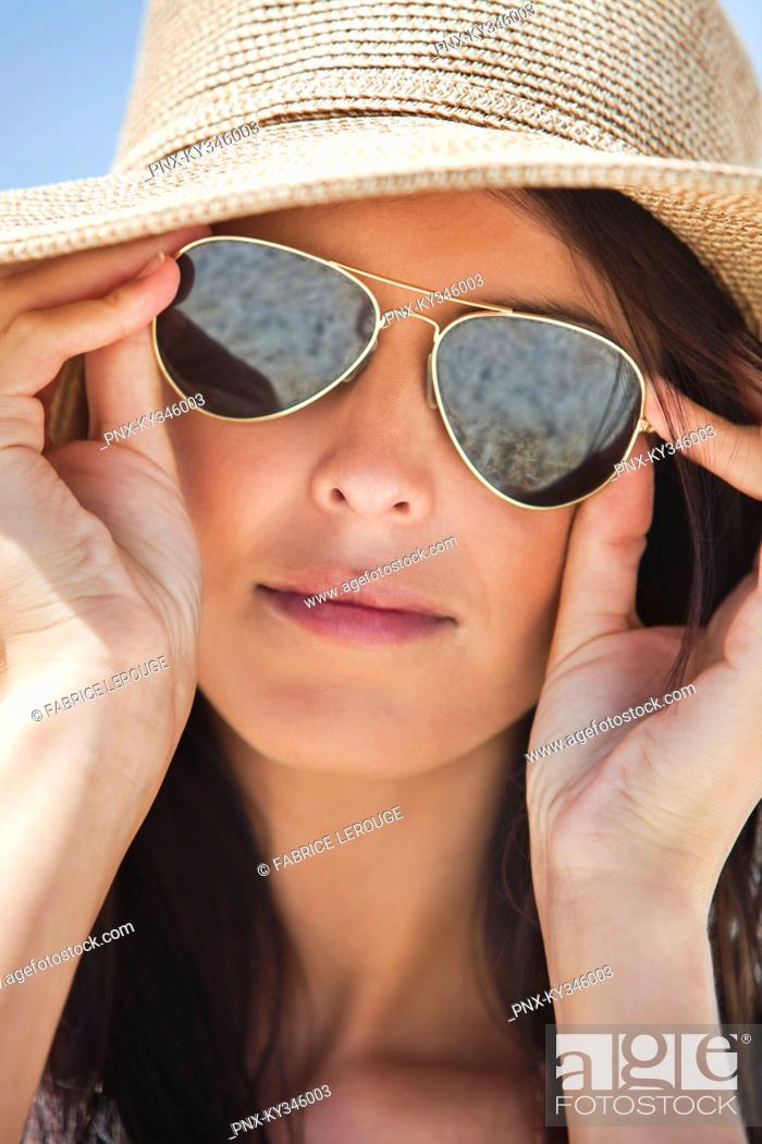 Stock Photo: Close-up of a woman wearing sunglasses.