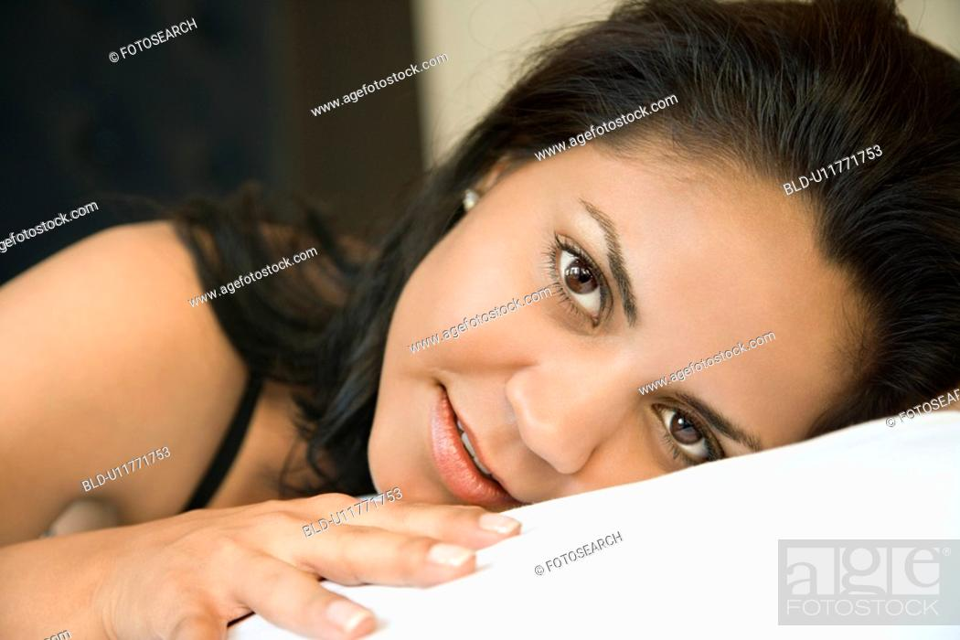 Stock Photo: Portrait of Hispanic young adult woman lying down.