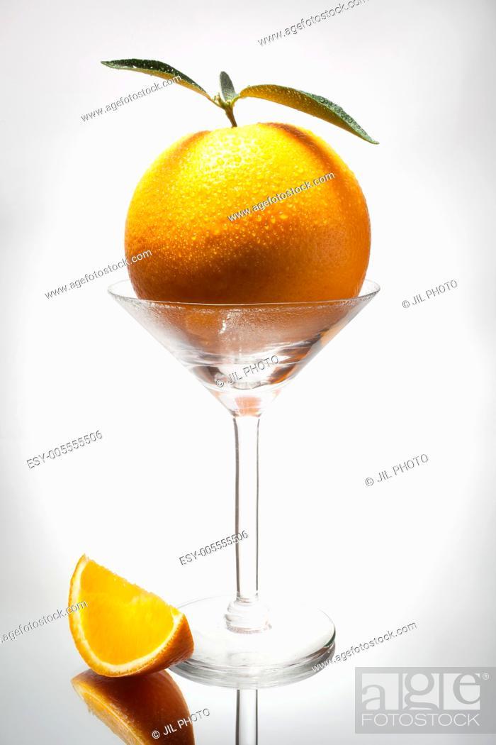Stock Photo: orange into cocktail glass.