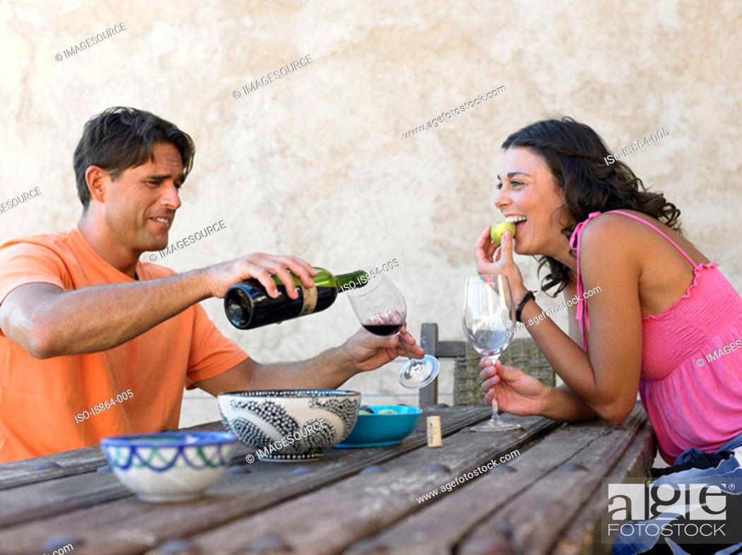 Stock Photo: Couple having wine.