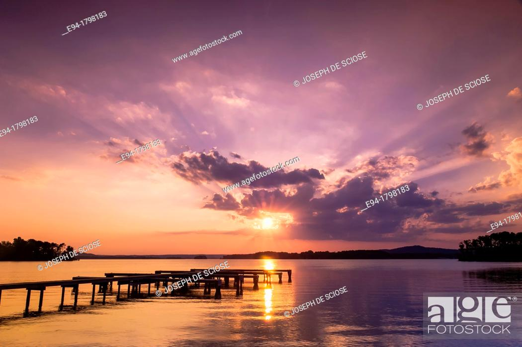 Stock Photo: Sunset over a lake with a small boat dock silhouetted in the foreground, Lake Guntersville State Park, Alabama, USA.