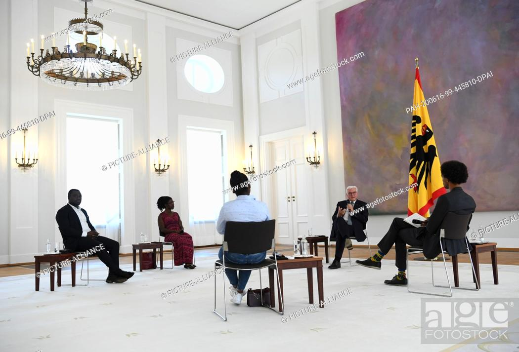 Stock Photo: dpatop - 16 June 2020, Berlin: Federal President Frank-Walter Steinmeier (2nd from right) talks to his guests, former German national football player Gerald.