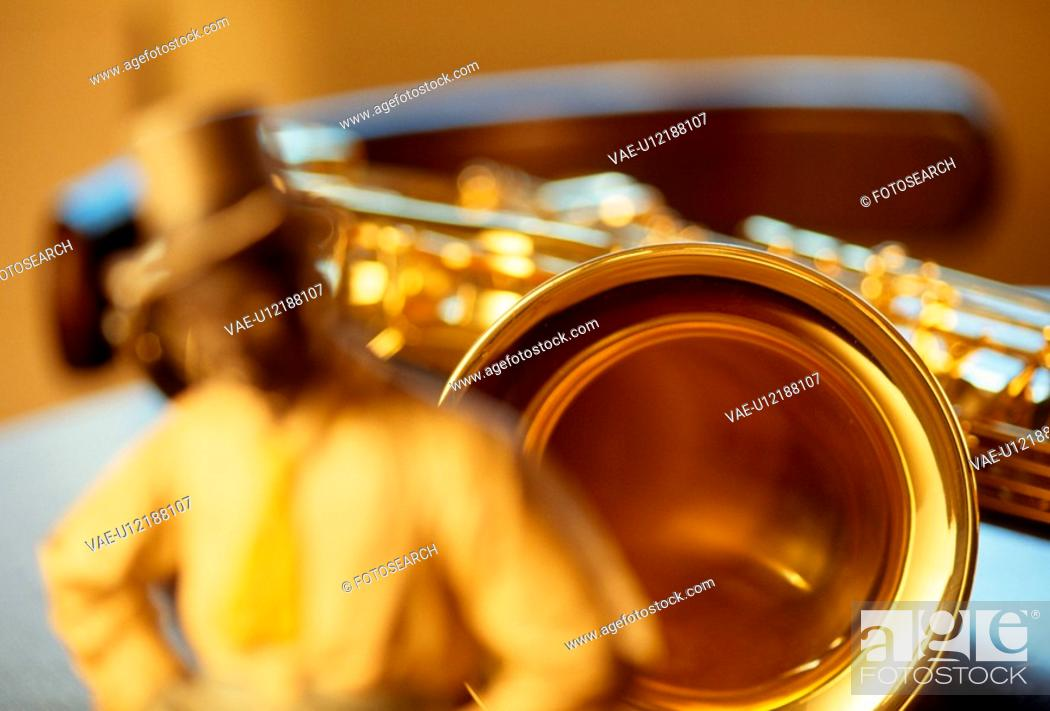 Stock Photo: A Jazzman And A Saxophone.