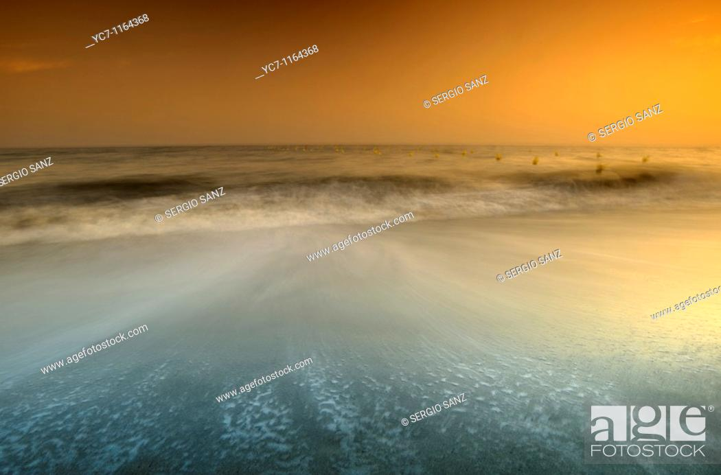 Stock Photo: sunset at the beach in malaga,spain.