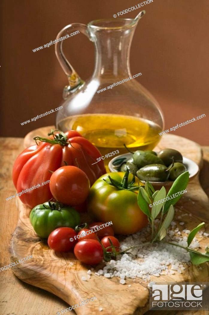 Stock Photo: Fresh tomatoes, olives, salt and olive oil.