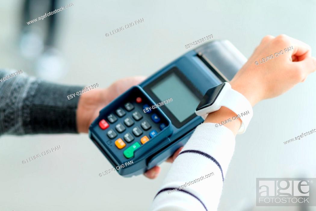 Stock Photo: Woman pay the bill on smartwatch by NFC.